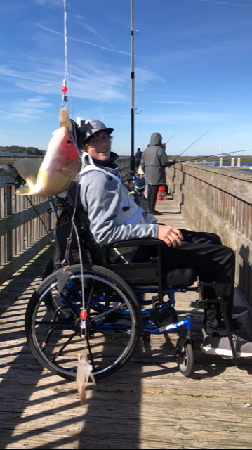 patient on a wheelchair fishing and ready to be part of the recreation therapy at brooks rehab