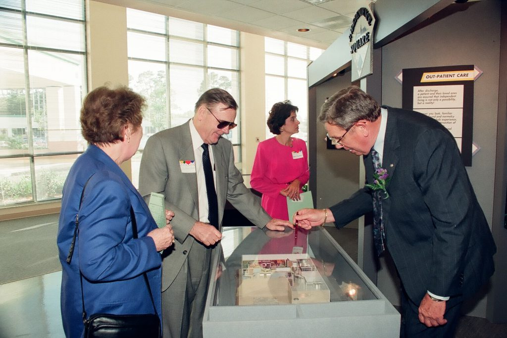 Dr. J. Brooks Brown looking at facility model