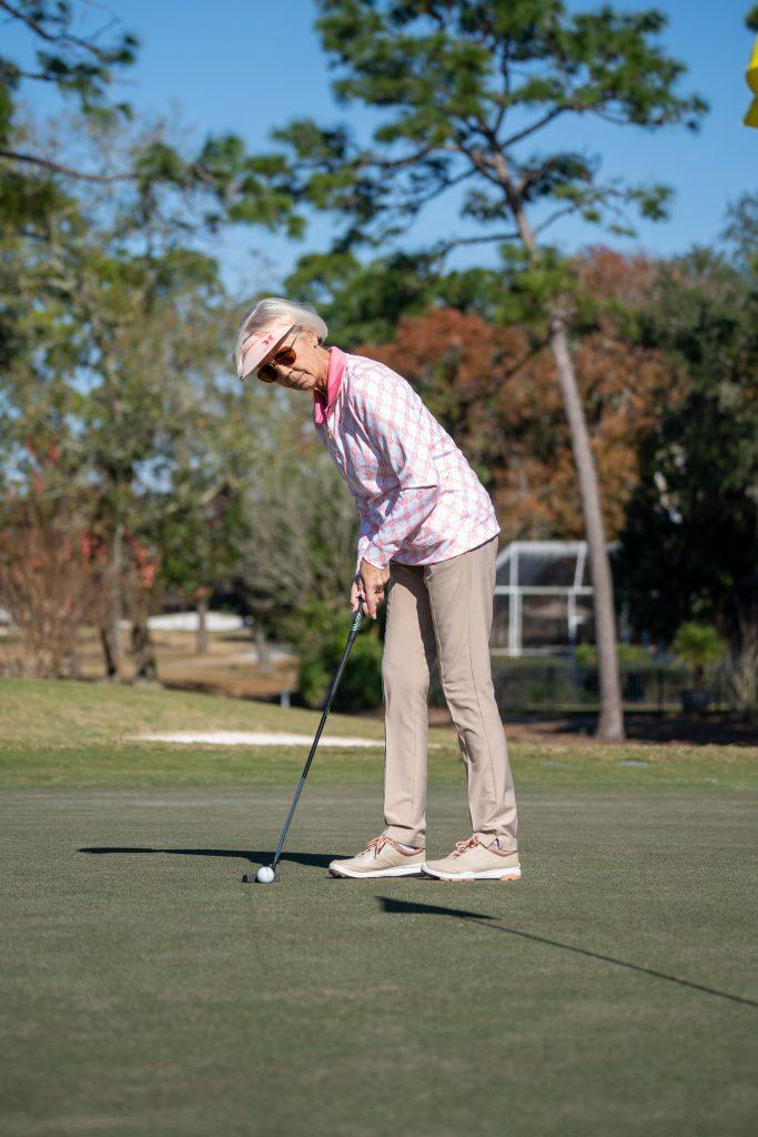 Lynne Sneed golfing