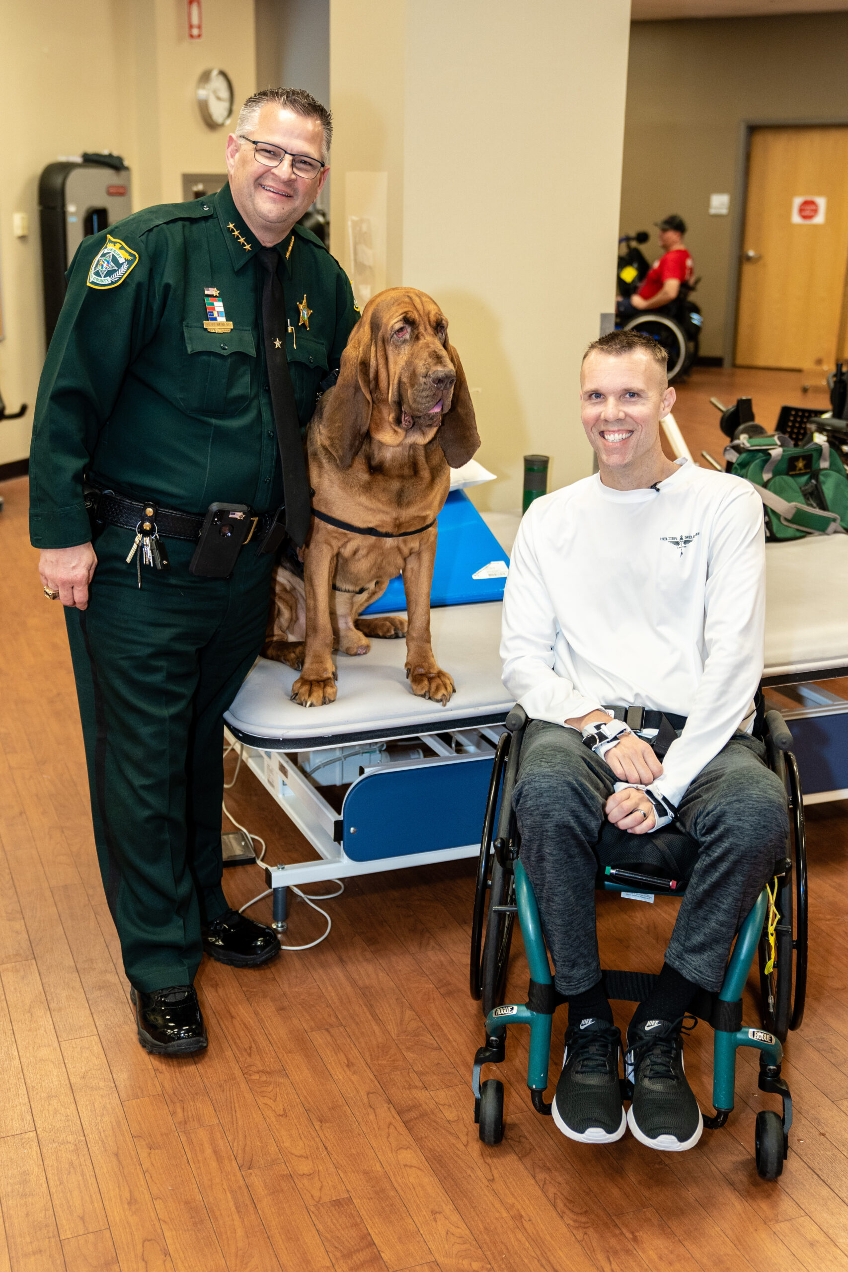 Chris Streiff with Sheriff and K9 at Brooks Rehabilitation Hospital